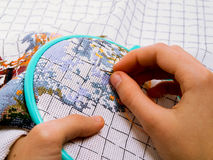 Embroidery in the childrens hands Royalty Free Stock Photography