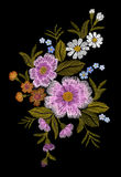 Embroidery colorful floral pattern with dog roses and forget me not flowers. Vector traditional folk fashion ornament on black bac Stock Image