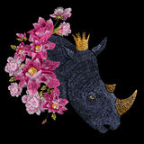 Embroidery colorful floral pattern with fantasy rhinoceros. Vector trend folk flowers ornament on black background royalty free illustration