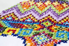 Embroidery colorful thread Navajo ornament royalty free stock photo