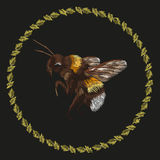 Embroidery colorful trend pattern with bumblebee. Vector folk striped bee with ring of leaves ornament on black background royalty free illustration