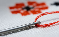 Embroidery concept. Macro of needle on criss-cross background Stock Photography
