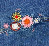 Embroidery on denim Stock Photo