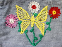 Embroidery on denim Stock Images
