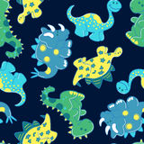 Embroidery dinosaurs in a seamless pattern.  Royalty Free Stock Images