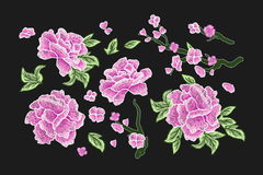 Embroidery. Embroidered design elements with sakura flowers and leaves isolated.Pink Flowers. Stock Photos