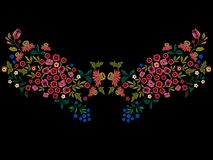 Embroidery ethnic neckline pattern with small wild flowers. Stock Photos
