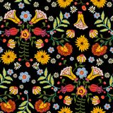 Embroidery ethnic seamless pattern with colorful flowers. Vector traditional floral bouquet. Tribal style design for fashion wearing Royalty Free Stock Image