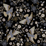 Embroidery ethnic seamless pattern with pigeons and flowers. Royalty Free Stock Images