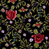 Embroidery ethnic seamless pattern with simplify red roses and rowanberry. Royalty Free Stock Images