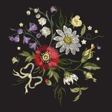 Embroidery floral pattern with poppy and chamomiles. Royalty Free Stock Images