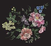 Embroidery floral pattern with rose, lilac and violets. Stock Photos