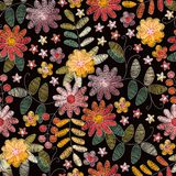 Embroidery floral seamless pattern with beautiful summer flowers on black background. Fashion design for fabric. Vector print royalty free illustration