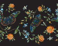 Embroidery floral seamless pattern with wild roses and butterflies. Stock Photos