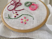 Embroidery with flower tendril Stock Photos