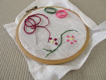 Embroidery with flower tendril Stock Photo