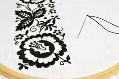 Embroidery flower. The traditional folklore embroidery tight on frame Royalty Free Stock Photography