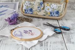 Embroidery Flowers. Sewing accessories. Canvas, hoop, thread mouline. Needlework. Hand embroidery. Embroidery Flowers. Sewing accessories. Canvas, hoop, thread Stock Images