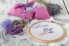 Embroidery Flowers. Sewing accessories. Canvas, hoop, thread mouline. Needlework. Hand embroidery royalty free stock photography