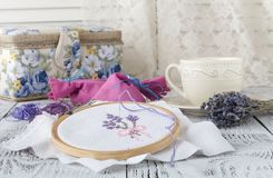 Embroidery Flowers. Sewing accessories. Canvas, hoop, thread mouline. Needlework. Hand embroidery stock photo