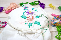 Flowers Embroidery. Sewing accessories. Canvas and hoop, thread. Embroidery Flowers. Sewing accessories. Canvas and hoop, thread mouline. Needlework. Hand Stock Image