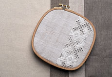 Embroidery fragment. Yarn, fabric. Detail of embroidery on canvas. Yarn, fabric in different colors and thicknesses Stock Photography