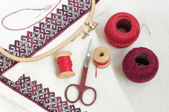 Embroidery fragment. Yarn, fabric. Fragment of embroidery on linen and accessories Royalty Free Stock Image