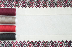 Embroidery fragment. Yarn, fabric. Fragment of embroidery on linen and accessories Royalty Free Stock Photos