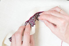 Embroidery fragment. Yarn, fabric. Royalty Free Stock Photos