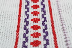 Embroidery. With a geometric pattern of red and purple colors Stock Image