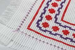 Embroidery. With a geometric pattern of red and purple colors Stock Photo