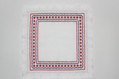 Embroidery. With a geometric pattern of red and purple colors Stock Photography