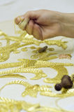 Embroidery in gold. The first plane of a woman realizing embroidery in gold Stock Photography
