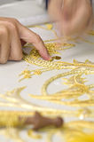 Embroidery in gold. The first plane of a woman realizing embroidery in gold Royalty Free Stock Images