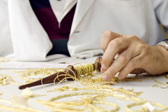 Embroidery in gold. The first plane of a woman realizing embroidery in gold Royalty Free Stock Image