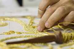 Embroidery in gold. The first plane of a woman realizing embroidery in gold Royalty Free Stock Photo