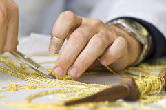 Embroidery in gold. The first plane of a woman realizing embroidery in gold Royalty Free Stock Photos