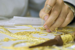 Embroidery in gold. The first plane of a woman realizing embroidery in gold Stock Image