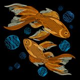 Embroidery with golden fish on a black background. Embroidered g. Oldfish. Vector illustration Royalty Free Stock Photography