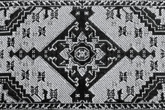 Embroidery graphic pattern. Closeup of stylized black and white seamless oriental embroidery pattern Stock Photos