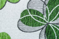 Embroidery of green leaf on linen beige fabric. Royalty Free Stock Photos