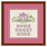 Embroidery Home Sweet Home Cross Stitch Wood Frame. Mahogany wood picture frame with cross stitch design, Home Sweet Home in pastel colors, needlework heart Royalty Free Stock Image