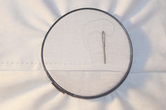 Embroidery hoop with running stitch and needle on Stock Photos