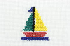 Embroidery of the image of a boat with a sail. Stock Images