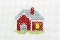 Embroidery of the image of a small house stock photography