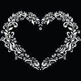 Embroidery inspired heart shape in white with floral elements on black background. Icon stock illustration