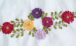 Embroidery on lace fabric. Royalty Free Stock Images