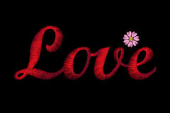 Embroidery lettering word Love. Red stiches field daisy Valentine Day Royalty Free Stock Images