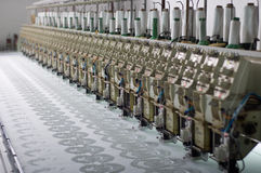 Embroidery machine. Close up of commercial embroidery machine Stock Images