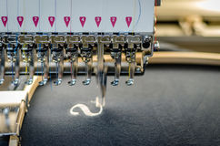 Embroidery machine close up. On embroidery field royalty free stock photo